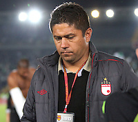 BOGOTA -COLOMBIA- 28 -11--2013. Wilson Gutierrez director tecnico del Independiente Santa Fe muestra su decepcion al perder de locales con el Atletico Nacional      , encuentro de los cuadrangulares finales de la Liga Postobon jugado en el estadio de El Campin / Wilson Gutierrez coach of Independiente Santa Fe show his sadness at losing local with Atletico Nacional, meeting the final matches  Postobon League played at El Campin Stadium .Photo: VizzorImage / Felipe Caicedol / Staff