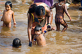 Altamira, Brazil. Kayapo women and children bathing.