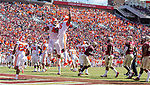 Clemson wide receiver Tee Higgins (5) and lineman Christin Wilkins celebrate Higgins' touchdown against Florida State in the first half of an NCAA college football game in Tallahassee, Fla., Saturday, Oct.27, 2018. Clemson defeated Florida State 59-10. (AP Photo/Mark Wallheiser)