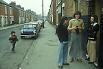Hull, Humberside. 1980<br /> Fashionable young fishermen, out of work and hanging around in Eton Street. Flares were popular, the wider the better. Eton Street was within the Hessle Road area of town, and was a traditional working class enclave and home to fishermen and docker workers.<br /> <br />  Working class neighbourhood. 1980s Unemployed young fishermen UK. Eton Street, Hessle Road area. <br /> <br /> Street name thanks to George Norris.