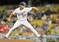 23 July 2011: Los Angeles Dodgers pitcher Mike MacDougal on the mound against the Washington Nationals at Dodger Stadium in Los Angeles, California. The Dodgers rallied to defeat the Nationals 7-6 on a Rafael Furcal walk-off, RBI double in the bottom of the 9th inning. Mandatory Credit: Ed Wolfstein Photo