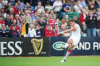 20120803 Copyright onEdition 2012©.Free for editorial use image, please credit: onEdition..Nils Mordt of Saracens takes a kick against Sale Sharks 7s at The Recreation Ground, Bath in the Final round of The J.P. Morgan Asset Management Premiership Rugby 7s Series...The J.P. Morgan Asset Management Premiership Rugby 7s Series kicked off again for the third season on Friday 13th July at The Stoop, Twickenham with Pool B being played at Edgeley Park, Stockport on Friday, 20th July, Pool C at Kingsholm Gloucester on Thursday, 26th July and the Final being played at The Recreation Ground, Bath on Friday 3rd August. The innovative tournament, which involves all 12 Premiership Rugby clubs, offers a fantastic platform for some of the country's finest young athletes to be exposed to the excitement, pressures and skills required to compete at an elite level...The 12 Premiership Rugby clubs are divided into three groups for the tournament, with the winner and runner up of each regional event going through to the Final. There are six games each evening, with each match consisting of two 7 minute halves with a 2 minute break at half time...For additional images please go to: http://www.w-w-i.com/jp_morgan_premiership_sevens/..For press contacts contact: Beth Begg at brandRapport on D: +44 (0)20 7932 5813 M: +44 (0)7900 88231 E: BBegg@brand-rapport.com..If you require a higher resolution image or you have any other onEdition photographic enquiries, please contact onEdition on 0845 900 2 900 or email info@onEdition.com.This image is copyright the onEdition 2012©..This image has been supplied by onEdition and must be credited onEdition. The author is asserting his full Moral rights in relation to the publication of this image. Rights for onward transmission of any image or file is not granted or implied. Changing or deleting Copyright information is illegal as specified in the Copyright, Design and Patents Act 1988. If you are in any way unsure of your right to publish this image p