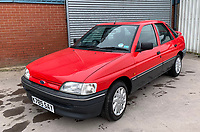 BNPS.co.uk (01202 558833)<br /> Pic: HampsonAuctions/BNPS<br /> <br /> Pictured: 1992 Ford Escort 1.4 LX.<br /> <br /> Since the 1990s, Geoff Barlow, 46, has collected dozens of classic cars from an Escort Mexico replica to several types of Transit, Cortina, and Sierra.<br /> <br /> However, he still regrets selling the first car which inspired his passion, a 1980 Escort Mark 2 he bought from his sister in 1992.  <br /> <br /> Geoff's fascination with Fords gathered pace in the last decade and he 'lost control,' buying as many Fords as he came across and saving them from disrepair.