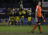 Oxford United players celebrate after Pelly-Ruddock Mpanzu of Luton Town scores a own goal and their second during the The Checkatrade Trophy Semi Final match between Luton Town and Oxford United at Kenilworth Road, Luton, England on 1 March 2017. Photo by Stewart  Wright  / PRiME Media Images.