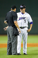 Winston-Salem Dash manager Ryan Newman (5) argues a call with home plate umpire Doug Del Bello during the Carolina League game against the Potomac Nationals at BB&T Ballpark on July 8, 2013 in Winston-Salem, North Carolina.  The Dash defeated the Nationals 12-9.  (Brian Westerholt/Four Seam Images)