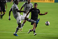 12th May 2021; Fort Lauderdale, Miami, USA;  Jean-Aniel Ass of CF Montreal clears the ball away from Midfielder Rodolfo Pizarro of Inter Miami CF at the Inter Miami CF match against CF Montreal on May 12, 2021 at DRV PNK Stadium.