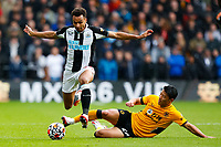 2nd October 2021;  Molineux Stadium, Wolverhampton,  West Midlands, England; EFL Cup football, Wolverhampton Wanderers versus Newcastle United; Jacob Murphy of Newcastle United skips over a tackle by Hwang Hee-Chan of Wolverhampton Wanderers