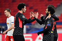 16th February 2021, Puskas Arena, Budapest, Hungary; Champions League football, FC Leipig versus Liverpool FC; Mohamed Salah (r) of Liverpool celebrates scoring his goal for 0:1 with his team-mates