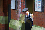 © Joel Goodman - 07973 332324 . 27/12/2017. Wigan, UK. A man dressed as a character from Peaky Blinders peaks around a corner. Revellers in Wigan enjoy Boxing Day drinks and clubbing in Wigan Wallgate . In recent years a tradition has been established in which people go out wearing fancy-dress costumes on Boxing Day night . Photo credit : Joel Goodman