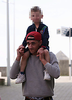 """COPY BY TOM BEDFORD<br /> Pictured: Tom Richards plays with an unknown boy on Swansea beach. STOCK PICTURE<br /> Re: Danniella Westbrook's cagefighter ex-boyfriend is about to become a dad after falling for another older woman.<br /> Serial toyboy Tom Richards, 27, told friends Danniela, 43, """"can't hold a candle"""" to his new love - brunette Cath Hughes who is a month away from giving birth.<br /> Richards kept the pregnancy secret after discovering his old flame Daniela suffered a miscarriage last year.<br /> But he and Cath, 32, have shown friends a 3D scan of the baby boy due in May.<br /> A pal of the couple said: """"Tom kept the lid on it after finding out that Danniela had lost her baby.<br /> """"He's moved on but he didn't want to rub her nose in it by announcing he's going to be a dad.<br /> """"He's found himself a good woman, she's a bit older than him but she's a good influence."""""""