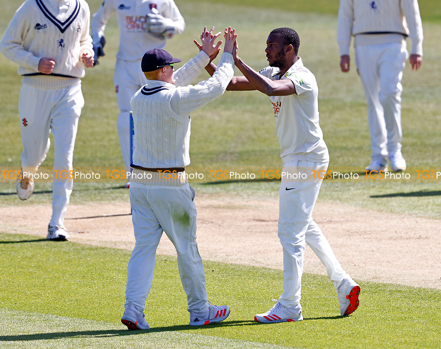 Miguel Cummins (R) of Kent is congratulated by Jordan Cox after taking the wicket of Luke Wells during Kent CCC vs Lancashire CCC, LV Insurance County Championship Group 3 Cricket at The Spitfire Ground on 22nd April 2021