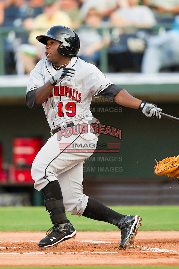 Josh Harrison #19 of the Indianapolis Indians follows through on his swing against the Charlotte Knights at Knights Stadium on July 26, 2011 in Fort Mill, South Carolina.  The Knights defeated the Indians 5-4.   (Brian Westerholt / Four Seam Images)