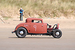 Pendine Sands - UK - 7th September 2013 :                                                                                    The First Annual Amateur Hot Rod Races at Pendine Sands off the coast of West Wales today. The event is being hosted by The Vintage Hot Rod Association.                                                                                                                      Pendine Sands is a seven mile long, arrow straight beach in South West Wales and was the place to go in the 1920's for land speed record attempts. Back then it drew big names such as Malcolm Campbell driving Bluebird, along with Parry Thomas piloting Babs, both hitting speeds in excess 170 miles per hour. It was following a terrible accident in 1927 when Thomas was decapitated that racing at Pendine Sands was called to a halt.