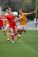 Brittany Bock (21) of the Western New York Flash (L) and Analisa Marquez (23) of the Atlanta Beat battle for the ball during the first half of WPS play at Sahlen's Stadium in Rochester, NY May 01, 2011. New York 3, Atlanta 0.