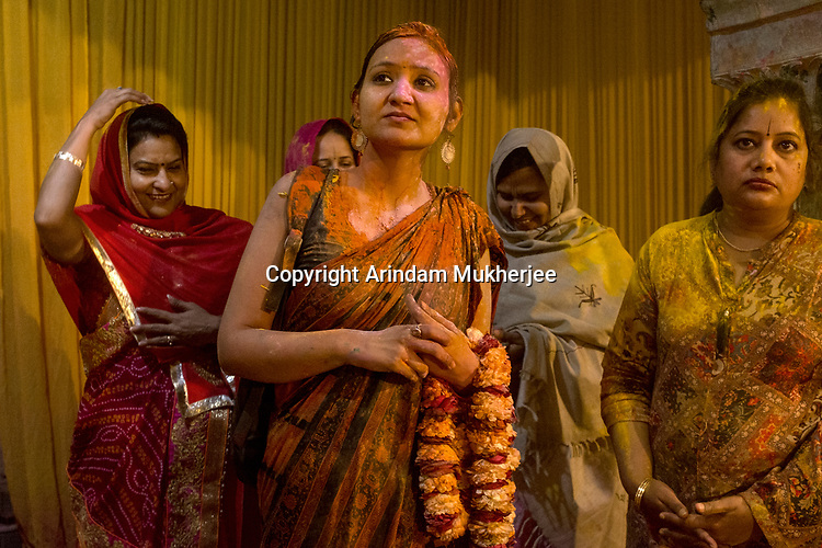 Women devotees at Radha Raman temple during Holi Festival  in Vrindavan. Holi - The  Hindu festival of colour is celibrated for a week in the Brraj region of Uttar Pradesh, India.