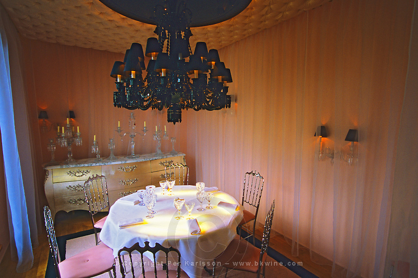 "The private dining room with the black crystal chandelier at The Baccarat Restaurant ""Le Cristal Room"", in the old dining room. Crystal chandeliers and glasses. Designed by Philippe Starck...The Cristal Room restaurant: the private dining room with the unique black crystal chandelier"