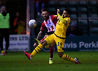 `l23` vies for possession with Milton Keynes Dons' Louis Thompson<br /> <br /> Photographer Andrew Vaughan/CameraSport<br /> <br /> The EFL Sky Bet League One - Lincoln City v Milton Keynes Dons - Tuesday 11th February 2020 - LNER Stadium - Lincoln<br /> <br /> World Copyright © 2020 CameraSport. All rights reserved. 43 Linden Ave. Countesthorpe. Leicester. England. LE8 5PG - Tel: +44 (0) 116 277 4147 - admin@camerasport.com - www.camerasport.com