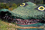 Gigantic alligator sculpture carved into rock