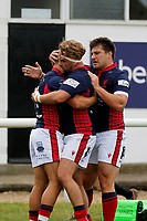 TRY - Luke Hibberd of London Scottish is congratulated during the Championship Cup match between London Scottish Football Club and Nottingham Rugby at Richmond Athletic Ground, Richmond, United Kingdom on 28 September 2019. Photo by Carlton Myrie / PRiME Media Images