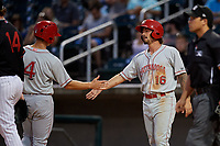 Chattanooga Lookouts Jonathan India (16) high fives Stuart Fairchild (4) during a Southern League game against the Birmingham Barons on July 24, 2019 at Regions Field in Birmingham, Alabama.  Chattanooga defeated Birmingham 9-1.  (Mike Janes/Four Seam Images)