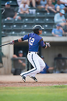 Missoula Osprey shortstop Brandon Leyton (12) follows through on his swing during a Pioneer League game against the Orem Owlz at Ogren Park Allegiance Field on August 19, 2018 in Missoula, Montana. The Missoula Osprey defeated the Orem Owlz by a score of 8-0. (Zachary Lucy/Four Seam Images)