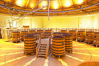 The winery with wooden and stainless steel fermentation vats. It is built in a circular design and made from chestnut wood to fight insects, Maison Louis Jadot, Beaune Côte Cote d Or Bourgogne Burgundy Burgundian France French Europe European