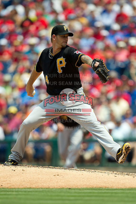 Pittsburgh Pirates starting pitcher AJ Burnett #34 delivers a pitch during the Major League Baseball game against the Philadelphia Phillies on June 28, 2012 at Citizens Bank Park in Philadelphia, Pennsylvania. The Pirates defeated the Phillies 5-4. (Andrew Woolley/Four Seam Images).