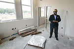 Dameion Crook stands in his office under construction at Leland College Preparatory Academy, April 25, 2017.