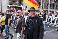 """Neonazis und Hooligans demonstrieren gegen Angela Merkel.<br /> Unter dem Motto """"Merkel muss weg"""" zogen ca. 1.200 am Samstag den 30. Juli 2016 mit einer Demonstration durch Berlin. Der Aufmarsch war vom einschlaegig bekannten Neonazi-Hooligan Enrico Stubbe angemeldet worden.<br /> Die Polizei hatte die Aufmarschroute der Rechten weitraeumig abgesperrt.<br /> Die Rechten forderten in Sprechchoeren immer wieder """"Nationalen Sozialismus! Jetzt!"""" (ein strafrechtlicher Trick, gemeint ist der Nationalsozialismus), beschimpften waehrend ihres Aufmarsches permanent Gegendemonstranten """"Wir kriegen euch alle"""" und """"Hurensoehne"""" und die Medienvertreter """"Luegenpresse"""". Mitarbeiter der Sicherheitsbehoerden erklaerten, dass es eindeutig ein rechtsextremer Aufmarsch gewesen sei bei dem sich keinerlei buergerliche Teilnehmer beteiligt haetten. Der Berliner Chef des Landesamt fuer Verfassungsschutz war persoenlich vor Ort um sich einen Eindruck zu verschaffen.<br /> Im Bild: Der Dresdner Pegida-Rechtsanwalt Jens Lorek.<br /> 30.7.2016, Berlin<br /> Copyright: Christian-Ditsch.de<br /> [Inhaltsveraendernde Manipulation des Fotos nur nach ausdruecklicher Genehmigung des Fotografen. Vereinbarungen ueber Abtretung von Persoenlichkeitsrechten/Model Release der abgebildeten Person/Personen liegen nicht vor. NO MODEL RELEASE! Nur fuer Redaktionelle Zwecke. Don't publish without copyright Christian-Ditsch.de, Veroeffentlichung nur mit Fotografennennung, sowie gegen Honorar, MwSt. und Beleg. Konto: I N G - D i B a, IBAN DE58500105175400192269, BIC INGDDEFFXXX, Kontakt: post@christian-ditsch.de<br /> Bei der Bearbeitung der Dateiinformationen darf die Urheberkennzeichnung in den EXIF- und  IPTC-Daten nicht entfernt werden, diese sind in digitalen Medien nach §95c UrhG rechtlich geschuetzt. Der Urhebervermerk wird gemaess §13 UrhG verlangt.]"""