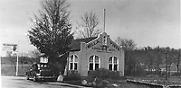 """Courtesy Bella Vista Historical Museum<br /> Pictured here is the Linebarger Brothers office built in 1928 of stucco with a red tile roof at the west end of the Lake Bella Vista dam. It replaced an earlier wood information booth built when they first opened the Bella Vista Summer Resort in 1917. After E. L. Keith bought the resort from the Linebargers in the 1950's, he decided to enlarge the office into a restaurant and grocery store. The building stood too close to the road for him to do that, so he moved it further east, closer to the dam. When John Cooper bought the resort from Keith in 1963, the enlarged building became part of the Cooper offices and stood until Cooper requested the Fire Department do a controlled burn in 1990 (by then the Cooper offices had long been headquartered in Village Hall, the former Sunset Hotel). This postcard was postmarked April 2,1948, and was addressed to """"The C.A. Linebargers, Bella Vista, Benton County, Arkansas."""" The message reads, """"Had the wanderlust and a camera on 3/26/48, so made ourselves at home on your grounds.""""  It was signed, """"The Curlees, Joplin."""""""