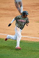 Arkansas Travelers shortstop Joey Wong (21) rounds third base during a game against the Frisco RoughRiders on May 28, 2017 at Dickey-Stephens Park in Little Rock, Arkansas.  Arkansas defeated Frisco 17-3.  (Mike Janes/Four Seam Images)