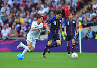 August 07, 2012..Mexico's Hiram Mier and Japan's Kensuke Nagai in action during Semi Final match at the Wembley Stadium on day eleven in Wembley, England. Mexico defeat Japan 3-1 to reach Men's Finals of the 2012 London Olympics...