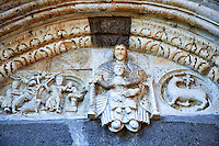 Lunette of the main portal with Romanesque sculptures of the Modona and child, centre, Abraham about to sleigh Isaac, left, and The lamb of God, right , Basilica Church of Santa Maria Maggiore, Tuscania