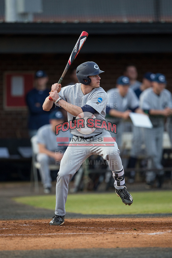 Luke Setzer (4) of the Catawba Indians at bat against the Belmont Abbey Crusaders at Abbey Yard on February 7, 2017 in Belmont, North Carolina.  The Crusaders defeated the Indians 12-9.  (Brian Westerholt/Four Seam Images)