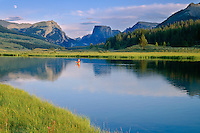Fly fishing on the Green River<br />   with White Rock and Squaretop Mountains<br /> Bridger National Forest,  Wind River Range<br /> Rocky Mountains,  Wyoming