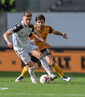 Fulham's Tom Cairney (left) under pressure from Wolverhampton Wanderers' Ruben Neves (right) <br /> <br /> Photographer David Horton/CameraSport<br /> <br /> The Premier League - Wolverhampton Wanderers v Fulham - Sunday 4th October 2020 - Molineux Stadium - Wolverhampton<br /> <br /> World Copyright © 2020 CameraSport. All rights reserved. 43 Linden Ave. Countesthorpe. Leicester. England. LE8 5PG - Tel: +44 (0) 116 277 4147 - admin@camerasport.com - www.camerasport.com