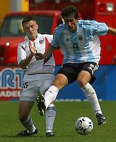 Bobby Convey, left, Diego Milito, right, Argentina vs. USA, Miami, Fla.