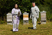 Pictured: Katie Robinson from the Principality and Ian Roberts of the Old Castle Farm Hives. Wednesday 23 June 2021<br /> Re: Prinicpality bee hive at Old Castle Farm Hives near Neath, Wales, UK