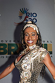 A female dancer from the Portela Samba School perform for the diplomats as part of the evening entertainment in front of a Rio+20 banner. United Nations Conference on Sustainable Development (Rio+20), Rio de Janeiro, Brazil, 13th June 2012. Photo © Sue Cunningham.