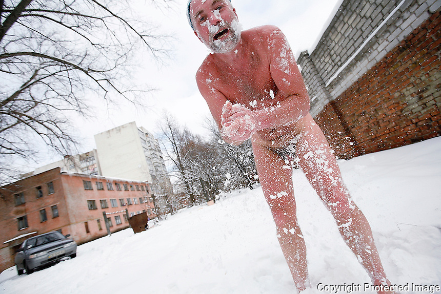 """Mostly, people do not get sick because of radiation. They get sick because they believe they are victims.""<br /> -- Sergii Mirnyi, author<br /> <br /> Sergii Mirnyi rolls in the snow after a sauna in Chernigiv, Ukraine. An eternal optimist, Mirnyi served in 1986 as commander of a radiation reconnaissance platoon adjacent to the Chernobyl plant.  <br /> ------------------- <br /> This photograph is part of Michael Forster Rothbart's After Chernobyl documentary photography project.<br /> © Michael Forster Rothbart 2007-2010.<br /> www.afterchernobyl.com<br /> www.mfrphoto.com <br /> 607-267-4893 o 607-432-5984<br /> 5 Draper St, Oneonta, NY 13820<br /> 86 Three Mile Pond Rd, Vassalboro, ME 04989<br /> info@mfrphoto.com<br /> Photo by: Michael Forster Rothbart<br /> Date:  2/2009    File#:  Canon 5D digital camera frame 56305.<br /> ------------------- <br /> Original caption: <br /> Chernobyl liquidator Sergii Mirnyi enjoys the banya in Chernigiv, Ukraine."