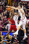 Florida State center Dominik Olejniczak (15) and guard Rayquan Evans (0) block the shot of Louisville guard Darius Perry (2) in the second half of an NCAA college basketball game in Tallahassee, Fla., Monday, Feb. 24, 2020. Florida State defeated Louisville 82-67.  (AP Photo/Mark Wallheiser)