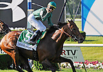 09 June 06: Garrett Gomez rides Gio Ponti (no. 5) to victory in the 108th running of the grade 1 Manhattan Handicap for three year olds and upwards at Belmont Park in Elmont, New York.