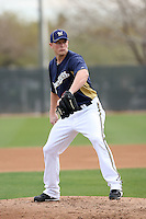 Justin James #46 of the Milwaukee Brewers participates in pitchers fielding practice during spring training workouts at the Brewers complex on February 18, 2011  in Phoenix, Arizona. .Photo by Bill Mitchell / Four Seam Images.