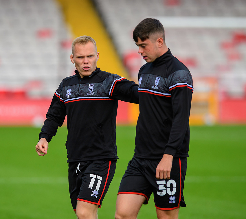 Lincoln City's Anthony Scully, with team-mate Sean Roughan during the pre-match warm-up<br /> <br /> Photographer Chris Vaughan/CameraSport<br /> <br /> The EFL Sky Bet League One - Saturday 12th September 2020 - Lincoln City v Oxford United - LNER Stadium - Lincoln<br /> <br /> World Copyright © 2020 CameraSport. All rights reserved. 43 Linden Ave. Countesthorpe. Leicester. England. LE8 5PG - Tel: +44 (0) 116 277 4147 - admin@camerasport.com - www.camerasport.com - Lincoln City v Oxford United