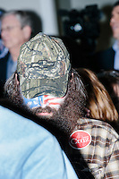 Rod Webber, also known as the Flower Man, sits in the audience with his face painted like an American flag as Texas senator and Republican presidential candidate Ted Cruz speaks at a town hall at Crossing Life Church in Windham, New Hampshire, on Tues. Feb. 2, 2016. The day before, Cruz won the Iowa caucus.
