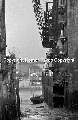 Shad Thames London Docklands Development 1980s. St Saviours Dock, old warehouses being developed. Bermondsey,  Southwark, South East London. 1987 UK.