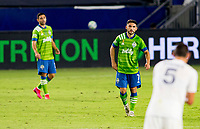 CARSON, CA - SEPTEMBER 27: Seattle Sounders teammates and brothers  Alex Roldan #16 and Cristian Roldan #7 exchange a few words with one another during a game between Seattle Sounders FC and Los Angeles Galaxy at Dignity Heath Sports Park on September 27, 2020 in Carson, California.