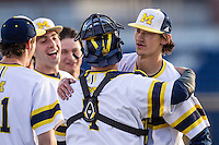 Michigan Wolverines pitcher Jackson Lamb (10) is hugged by catcher Harrison Wenson (7) after recording a save against the Central Michigan Chippewas on March 29, 2016 at Ray Fisher Stadium in Ann Arbor, Michigan. Michigan defeated Central Michigan 9-7. (Andrew Woolley/Four Seam Images)