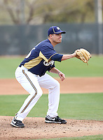 Manny Parra #26 of the Milwaukee Brewers participates in pitchers fielding practice during spring training workouts at the Brewers complex on February 18, 2011  in Phoenix, Arizona. .Photo by Bill Mitchell / Four Seam Images.