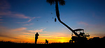 Photographer Neil Branch takes photos of his dog, Google, at sunset on the beach at Shell Point Beach along the Forgotten Coast of the Florida panhandle.